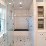 A bathroom shower with white tiles.