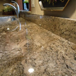 A sparkling granite countertop surface after cleaning and sealing.