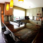 dark-granite-kitchen-countertop-stainless-steel-backsplash