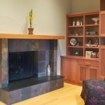 An example of dark travertine tiles lining a fireplace.