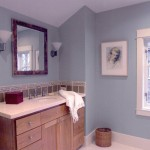 An example of a white bathroom granite countertop and blue painted walls.